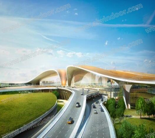 """新机场造型上像""""凤凰展翅"""",建筑立面主要为玻璃幕墙,以通透的墙面"""