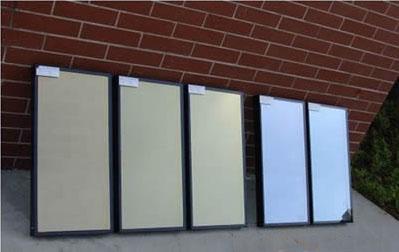 垂直式生产工艺中,玻璃垂直放置在架子上,送入10-1帕数量级的真空